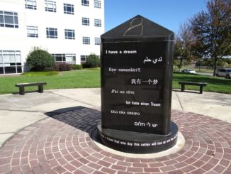Marker at MLK Plaza with quotes from Dr. King