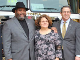 Fire chief, mayor and three city council members in front of new fire truck