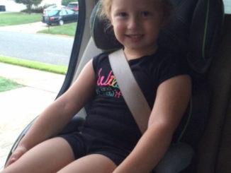 Older child in forward-facing car seat