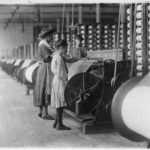 Young woman and young girl working at Loray Mill.