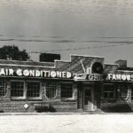 "Minute Grill with ""Air Conditioned"" sign in about 1940"