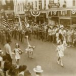 Baton twirlers lead the way in a 1940s parade on Main Avenue
