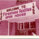 "Sign on building says ""1955 - Welcome to Firestone Textiles Open House"""
