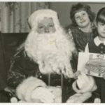 Santa and three children at Loray Mill