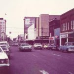 Cars driving on one-way Main Avenue in the 1970s