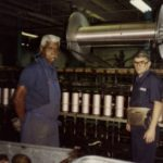 Two men working at Firestone plant