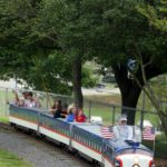 Families wave hello as they ride the Lineberger Park train