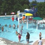 Dozens of people in the swimming pool at Lineberger Park