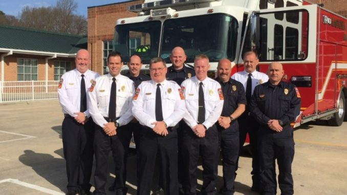 Nine Gastonia firefighters in front of fire truck