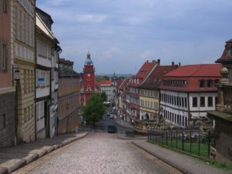 Old buildings, cobblestone streets, church steeple in Gotha, Germany