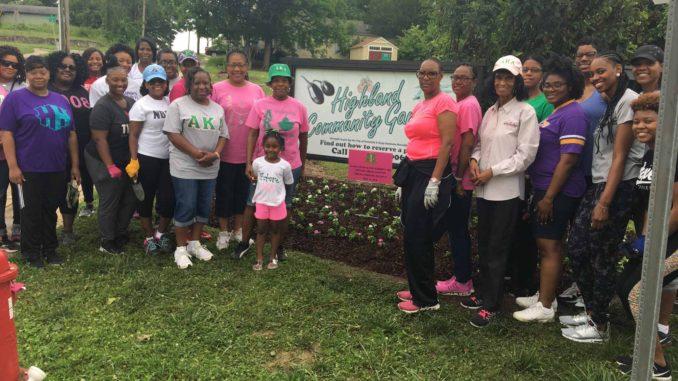 Volunteers plant flowers