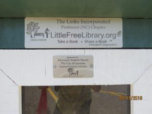 Plaques identifying as a Little Free Library