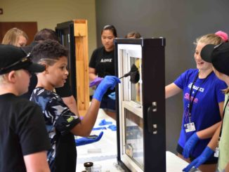 Students dust for fingerprints at CSI camp