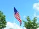 American flag against blue sky