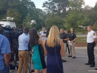 Outdoor news conference at Rankin Lake Park
