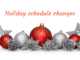 "Red and silver Christmas ornaments with words ""Holiday schedule changes"""