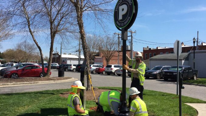 Downtown parking sign installation