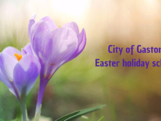 Purple spring flowers with words City of Gastonia Easter holiday schedule