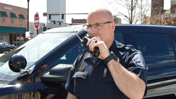 Police officer talking on portable radio