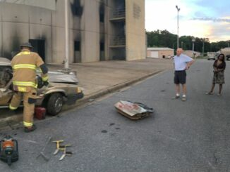 Citizens Academy participants watch fire crews extinguish a car fire
