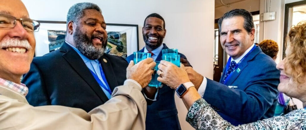 City leaders give a toast with glasses of water