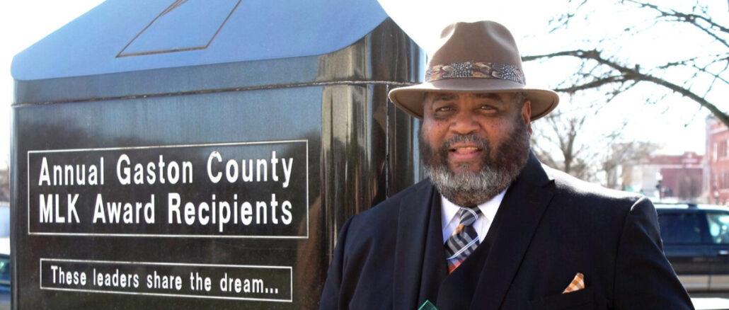 Walker Reid next to MLK monument in Gastonia