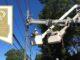 Linemen repairing electric lines, Public Power award logo
