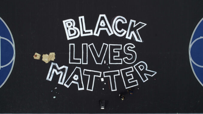 Black Lives Matter being painted on basketball court