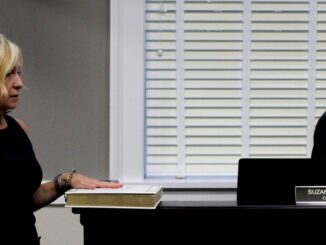 Clerk Suzanne Gibbs taking oath of office
