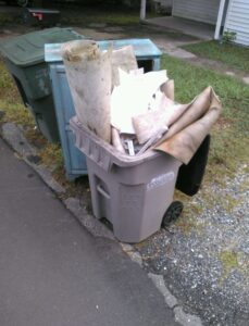 Recycling bin filled with flooring scraps
