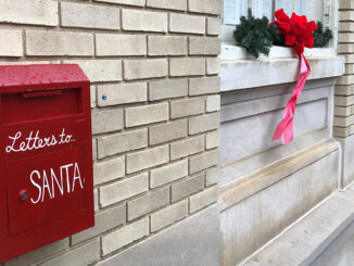 Red mailbox that says Letters to Santa at City Hall