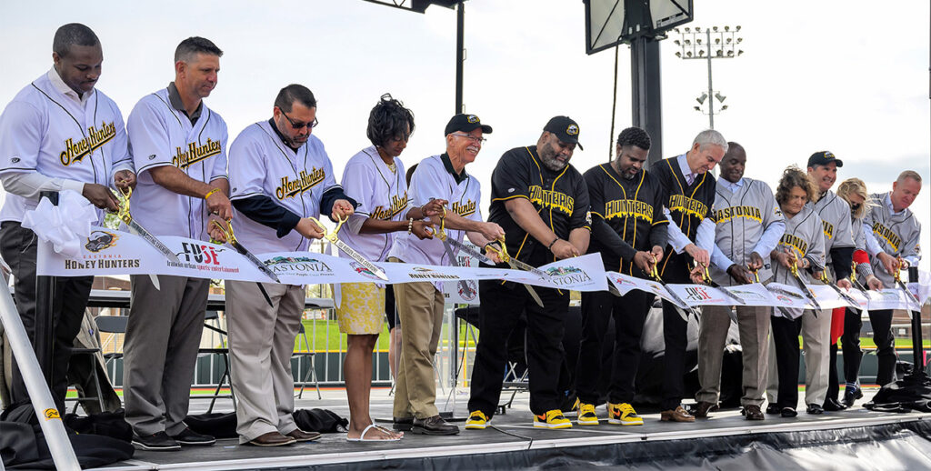 City officials cutting the ribbon at the FUSE ballpark